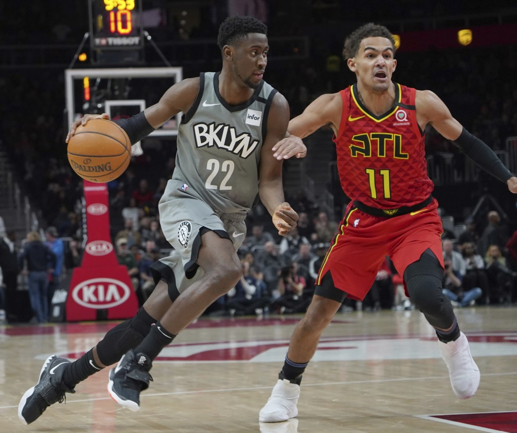 Brooklyn Nets' Caris LeVert (22) drives around Atlanta Hawks Trae Young (11) in the first half of an NBA basketball game Friday, Feb. 28, 2020, in Atl...