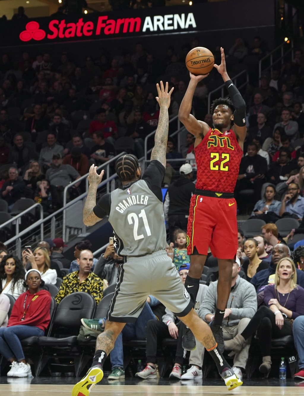 Atlanta Hawks' Cam Reddish (22) shoots for three points over Brooklyn Nets' Wilson Chandler (21) in the second half of an NBA basketball game Friday, ...