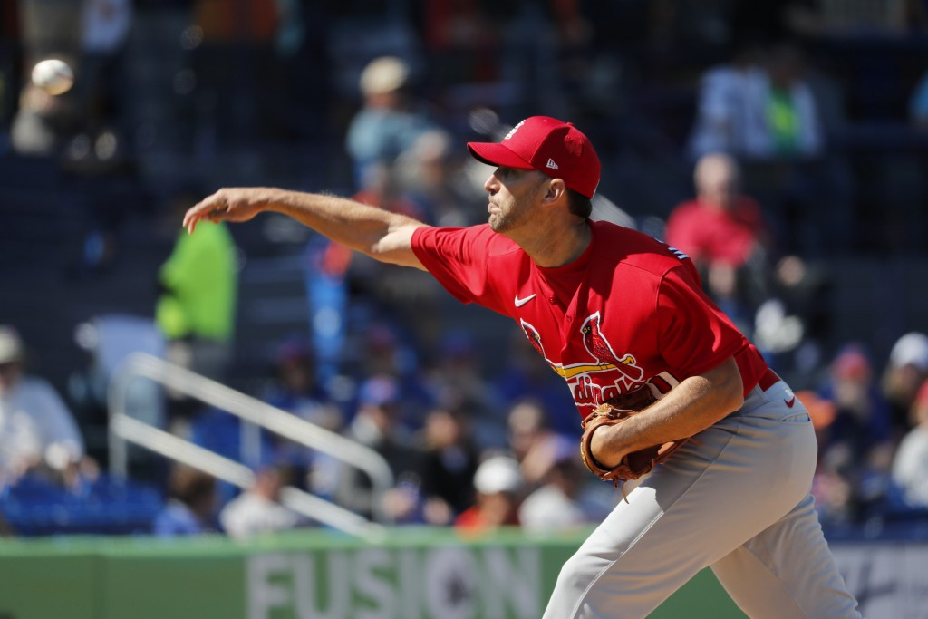 St. Louis Cardinals pitcher Adam Wainwright throws during the second inning of a spring training baseball game against the New York Mets Friday, Feb. ...