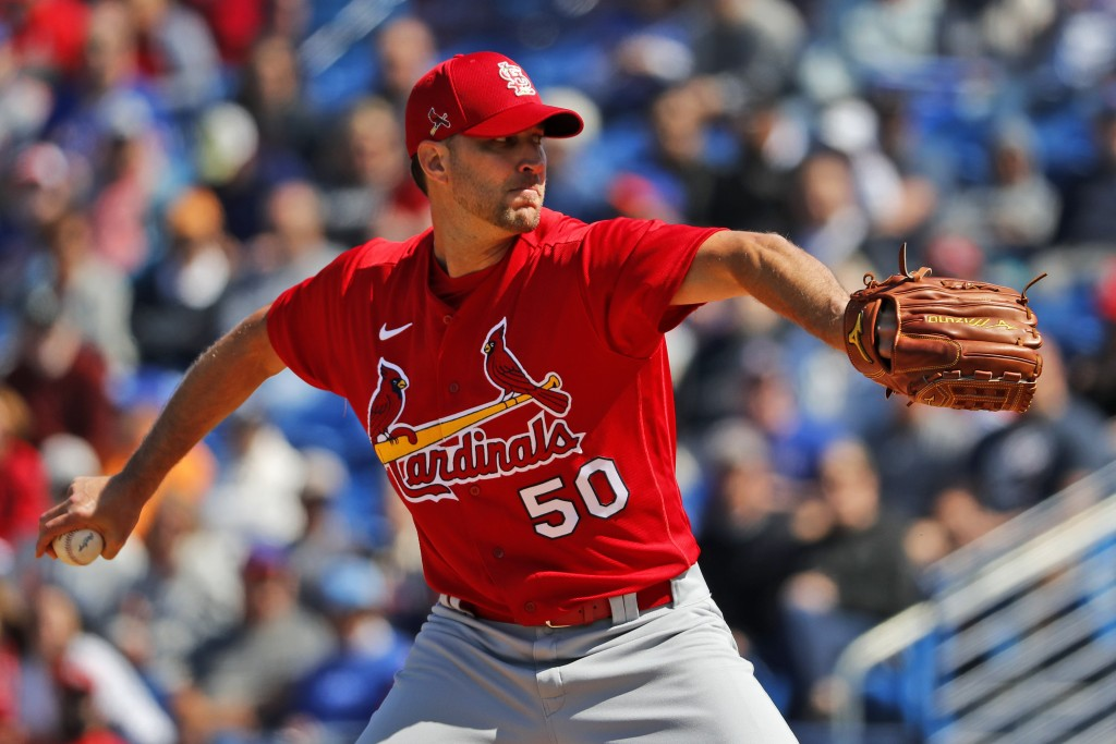 St. Louis Cardinals pitcher Adam Wainwright throws during the first inning of a spring training baseball game against the New York Mets Friday, Feb. 2...