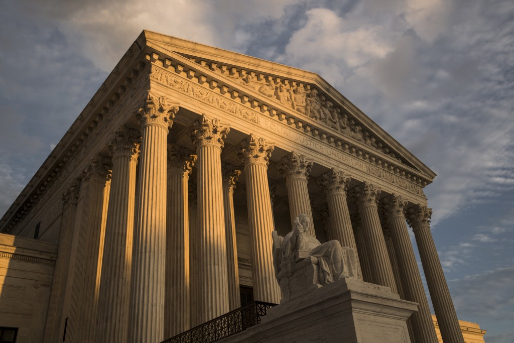 FILE - In this Oct. 10, 2017, file photo, the Supreme Court in Washington, at sunset. The Supreme Court is hearing arguments March 2, 2020, to decide ...