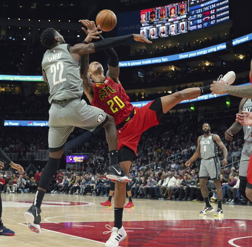 Brooklyn Nets Caris LeVert (22) battles for the ball with Atlanta Hawks John Collins (20) in the second half of an NBA basketball game Friday, Feb. 28...