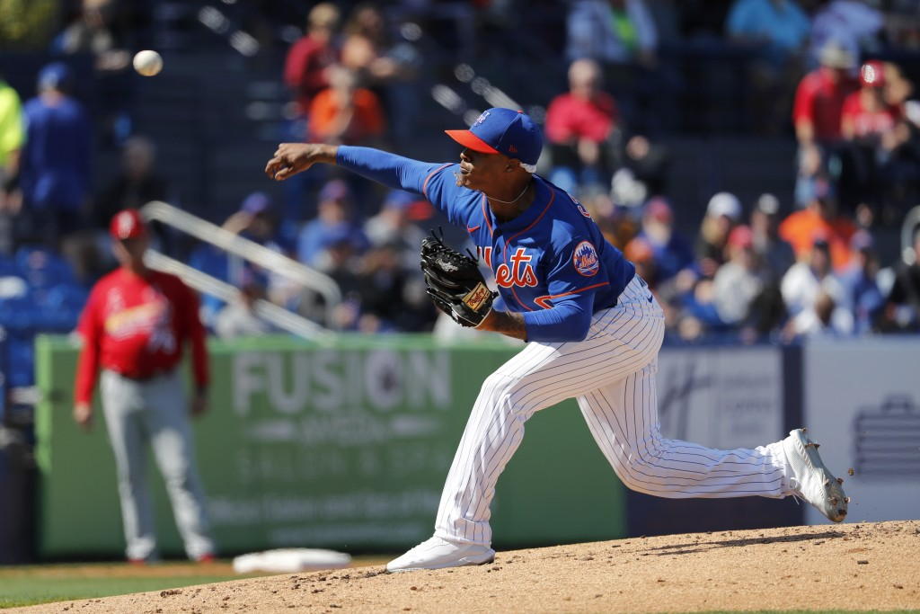 New York Mets pitcher Marcus Stroman throws during the second inning of a spring training baseball game against the St. Louis Cardinals Friday, Feb. 2...