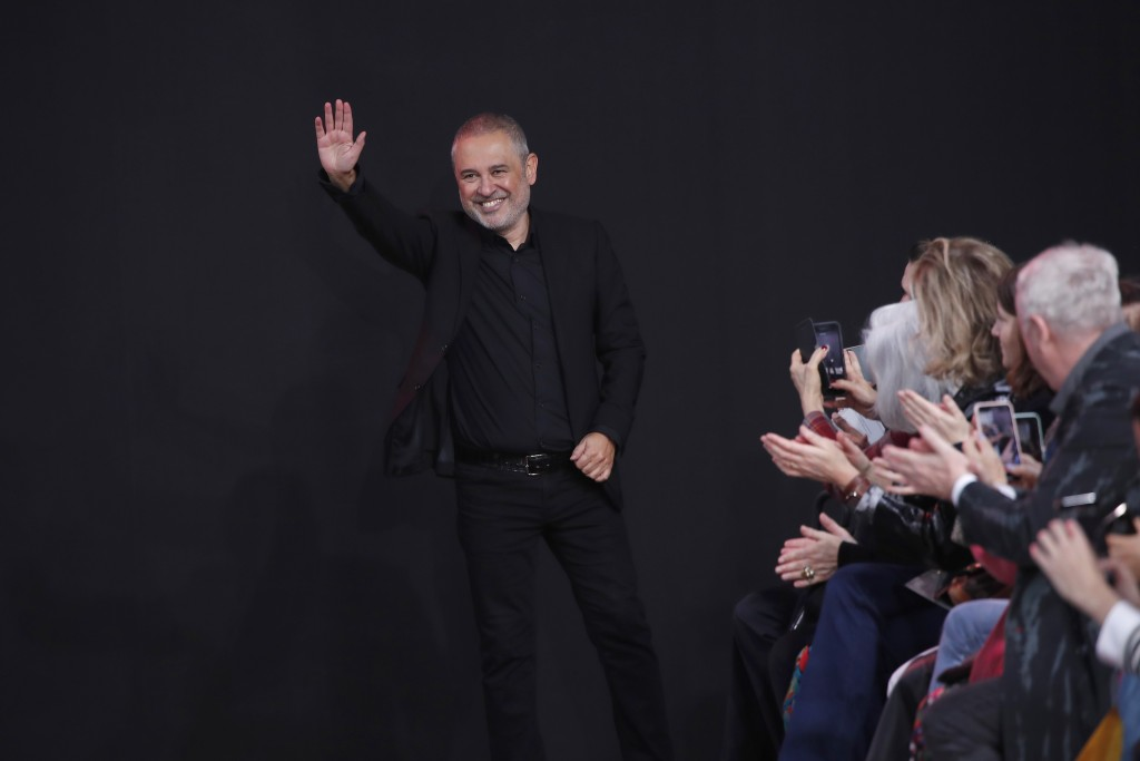 Designer Elie Saab accepts applause at the conclusion of his fashion collection during Women's fashion week Fall/Winter 2020/21 presented in Paris, Sa...