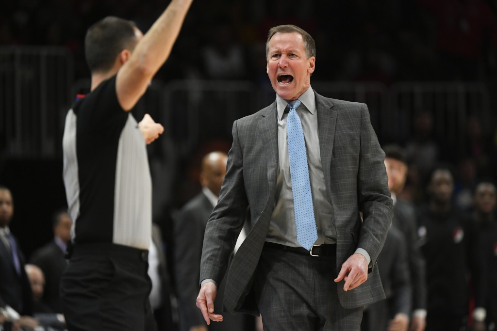 Portland Trail Blazers head coach Terry Stotts, right, shouts at referee Kane Fitzgerald before being called for a technical foul during the first hal...