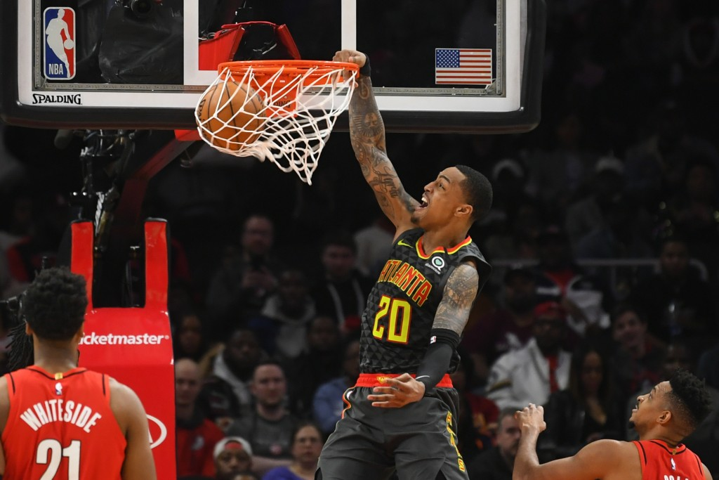 Atlanta Hawks forward John Collins (20) dunks during the second half of an NBA basketball game against the Portland Trail Blazers, Saturday, Feb. 29, ...