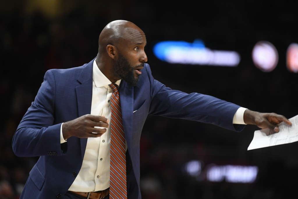 Atlanta Hawks coach Lloyd Pierce motions from the sideline during the second half of an NBA basketball game against the Portland Trail Blazers, Saturd...