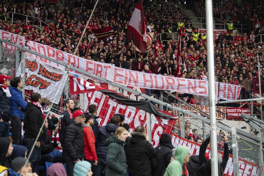 Bayern Munich supporters lift a banner reading 'Hopp remain a son of a bitch' against Hoffenheim club patron Dietmar Hopp during the German Bundesliga...