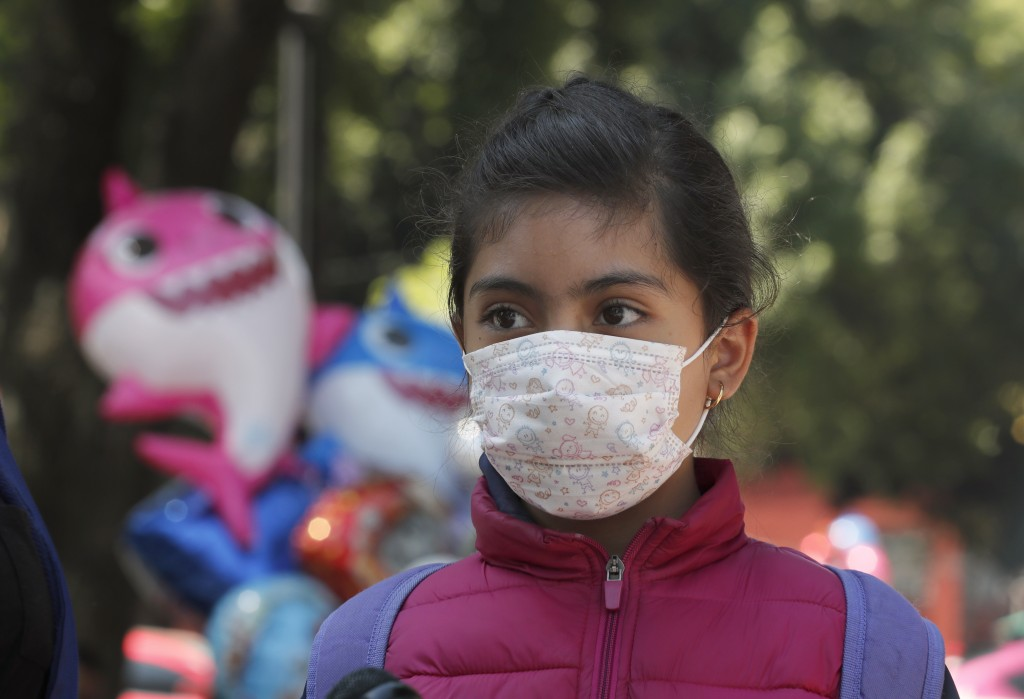 A child wears a medical mask as a precaution against the spread of the new coronavirus, during an outing in Mexico City, Saturday, Feb. 29, 2020. Mexi...