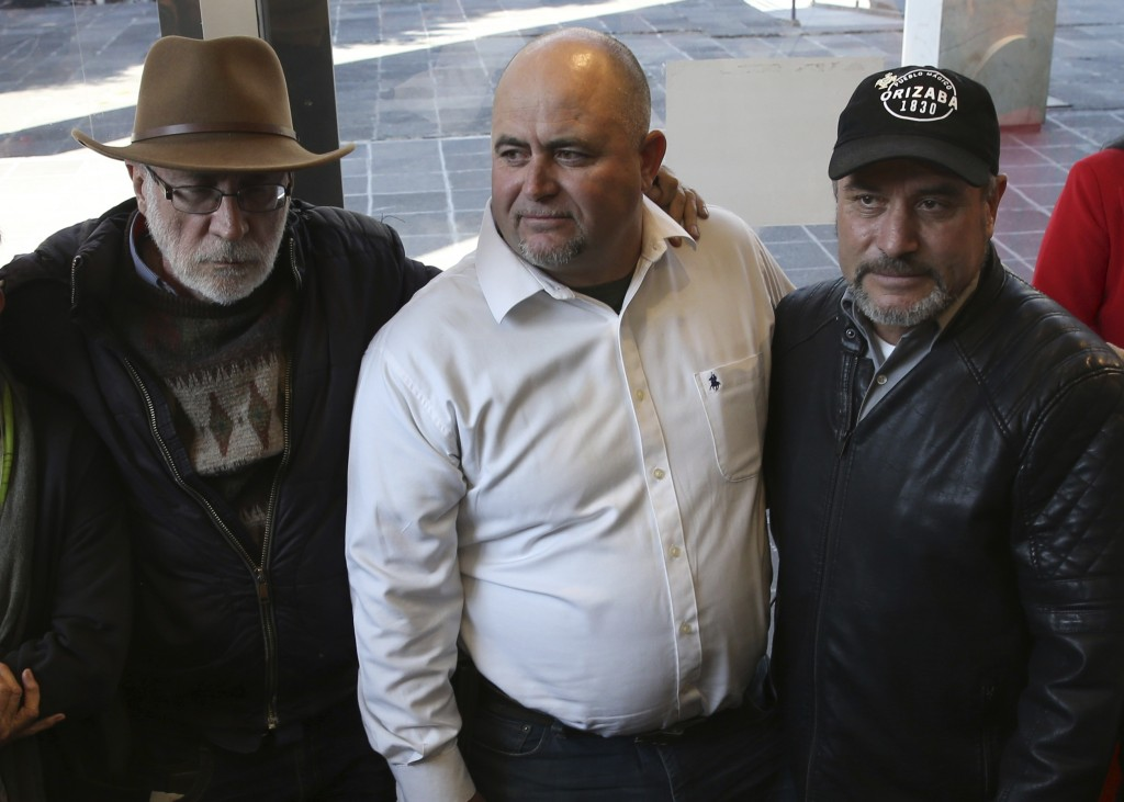 FILE - In this Jan. 9, 2019 file photo, Mexican writer and activist Javier Sicilia, from left, Julian LeBaron and brother Adrian, pose for photos duri...