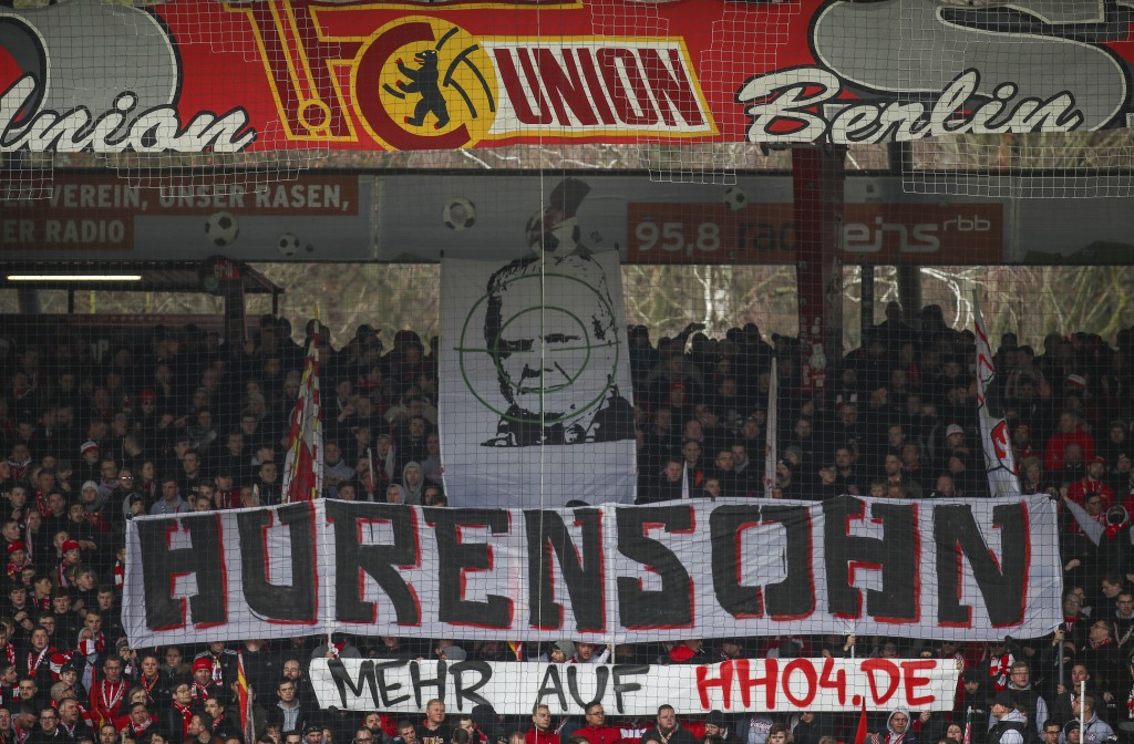 "Union fans on the tribune display a banner reading ""Son of a bitch"" against TSG Hoffenheim club patron Dietmar Hopp during the German Bundesliga socce..."