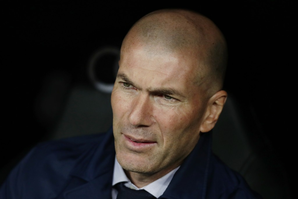 Real Madrid's head coach Zinedine Zidane waits for the start of the Spanish La Liga soccer match between Real Madrid and Barcelona at the Santiago Ber...