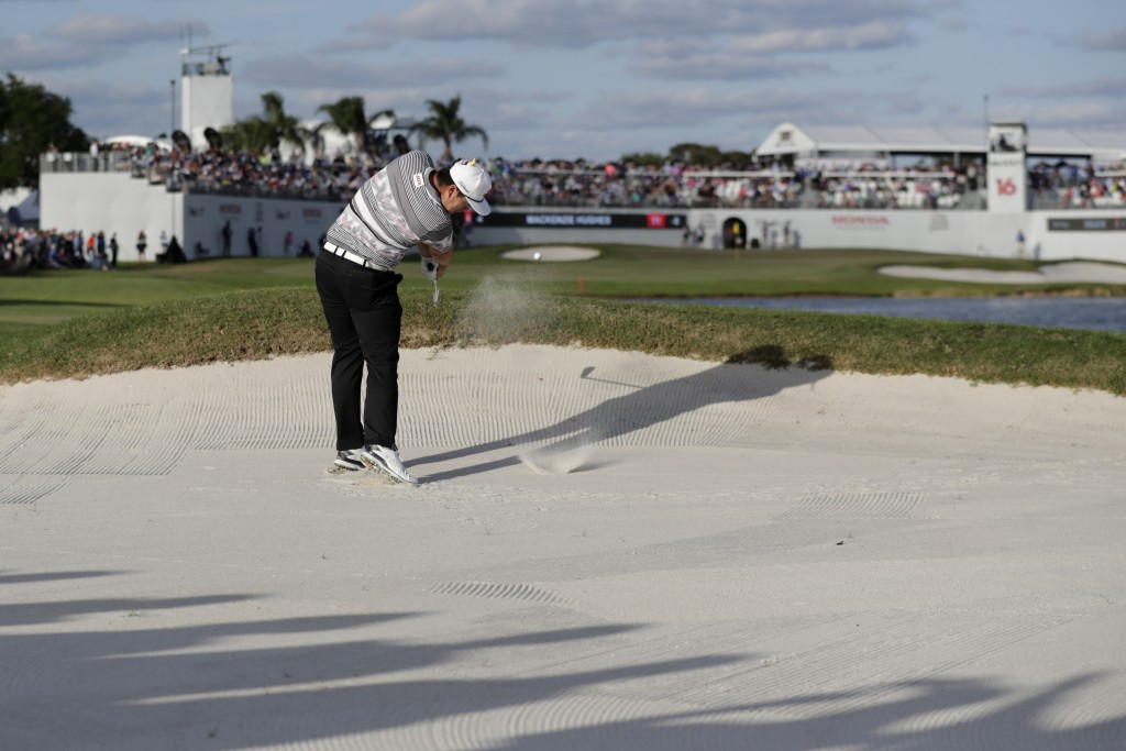 Sungjae Im of South Korea hits from a bunker on the 16th hole during the final round of the Honda Classic golf tournament, Sunday, March 1, 2020, in P...