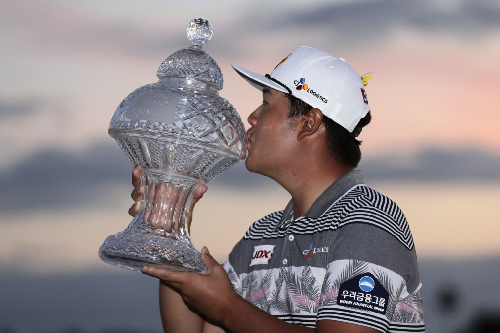 Sungjae Im of South Korea kisses the trophy after winning the Honda Classic golf tournament, Sunday, March 1, 2020, in Palm Beach Gardens, Fla. (AP Ph...