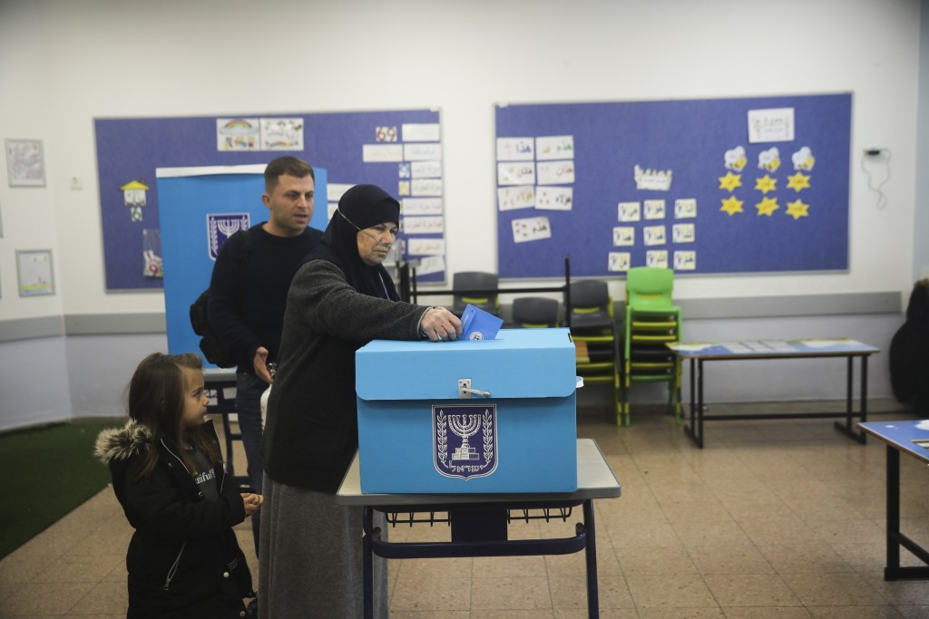 People vote during elections in Tamra, an Arab town in Israel, Monday, March 2, 2020. (AP Photo/Mahmoud Illean)