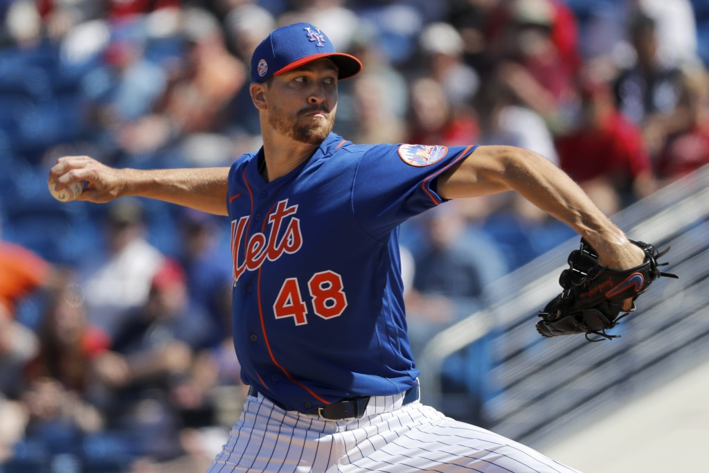 New York Mets pitcher Jacob deGrom throws during the first inning of a spring training baseball game against the Washington Nationals Sunday, March 1,...