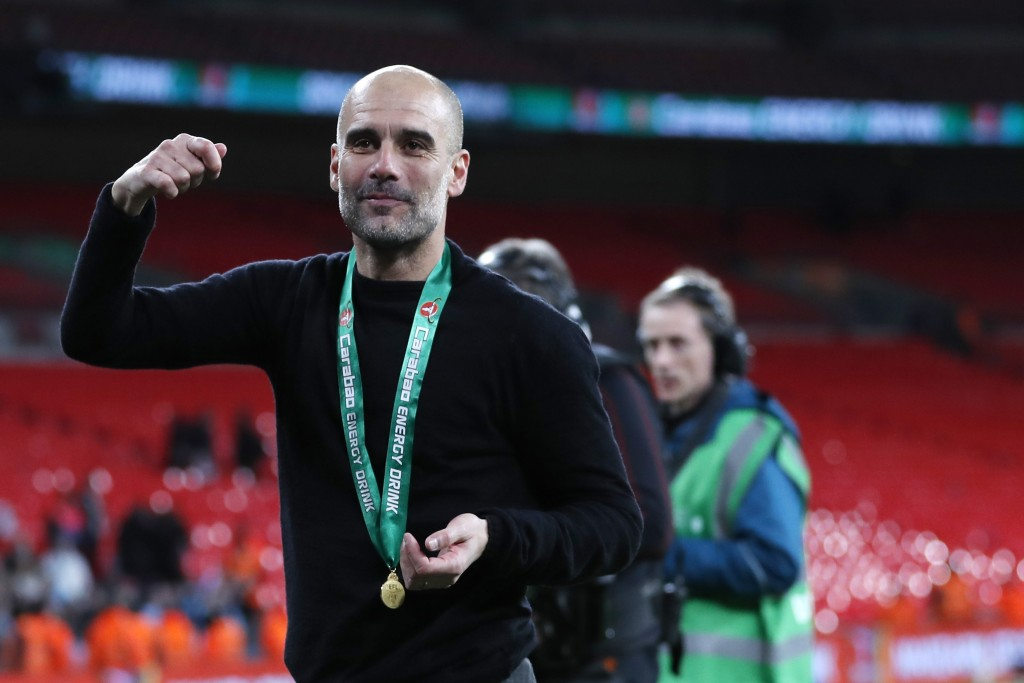 Manchester City's head coach Pep Guardiola celebrates after winning the English League Cup Final soccer match between Aston Villa and Manchester City,...