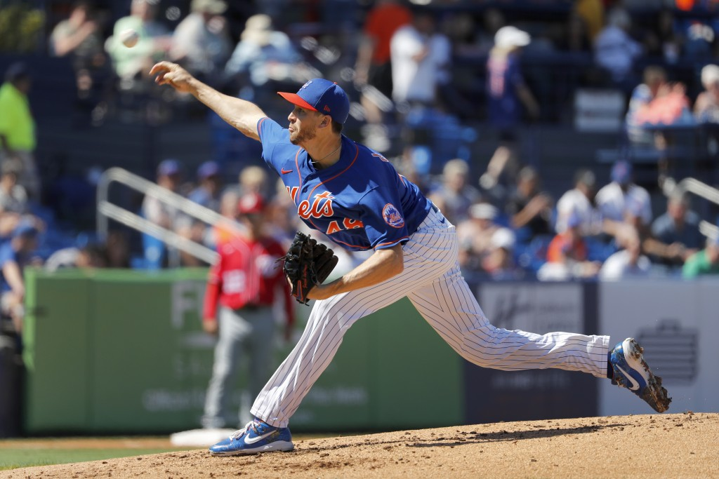 New York Mets pitcher Jacob deGrom throws during the second inning of a spring training baseball game against the Washington Nationals Sunday, March 1...