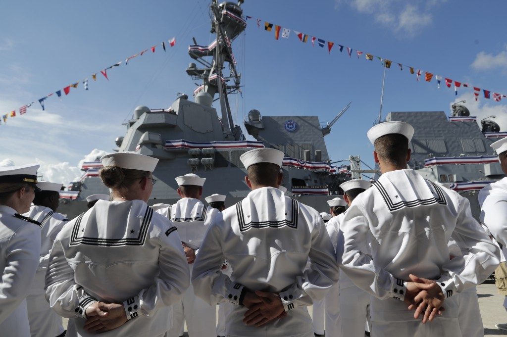 FILE - In this Saturday, July 27, 2019, file photo, sailors stand during a commissioning ceremony for the U.S. Navy guided missile destroyer USS Paul ...