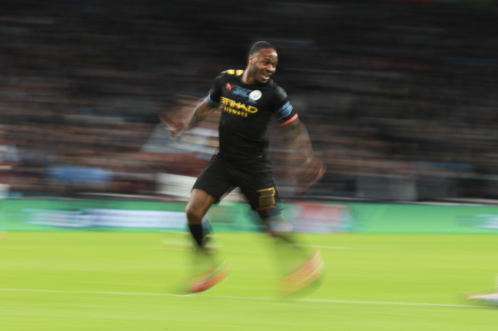 Manchester City's Raheem Sterling runs during the League Cup soccer match final between Aston Villa and Manchester City, at Wembley stadium, in London...