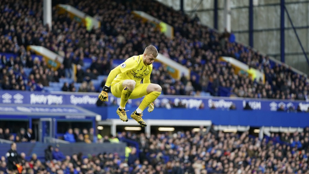 Everton's goalkeeper Jordan Pickford jumps on the pitch during the English Premier League soccer match between Everton and Manchester United at Goodis...