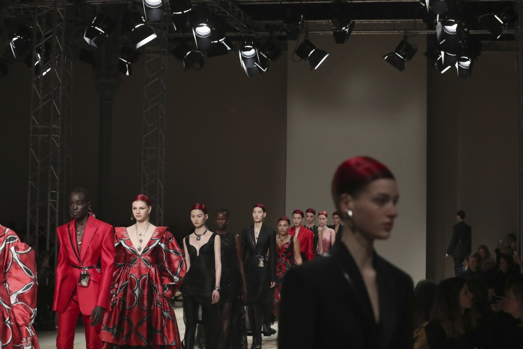 Models wear creations for the Alexander McQueen fashion collection during Women's fashion week Fall/Winter 2020/21 presented in Paris, Monday, March 2...