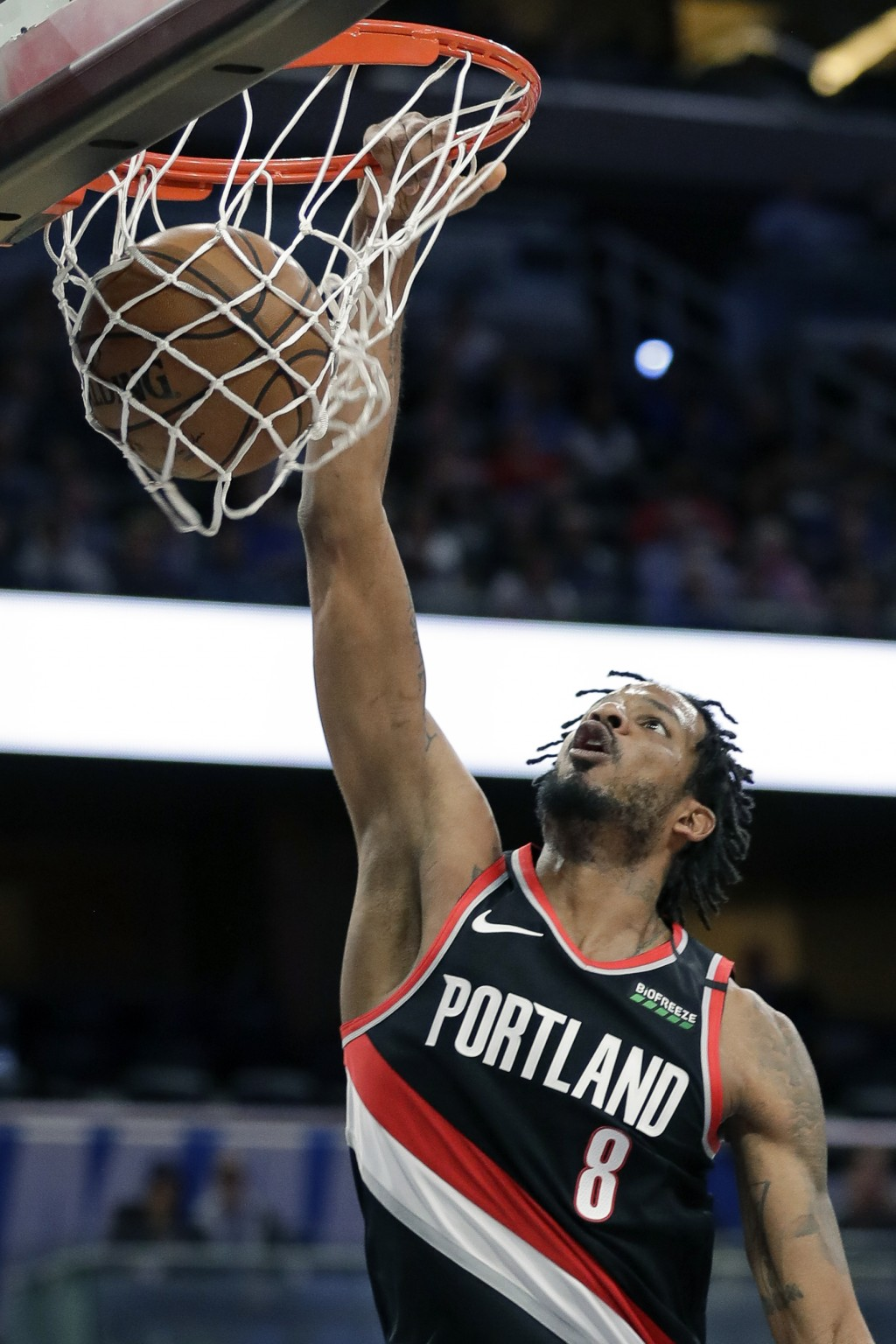 Portland Trail Blazers forward Trevor Ariza makes an uncontested dunk against the Orlando Magic during the first half of an NBA basketball game, Monda...