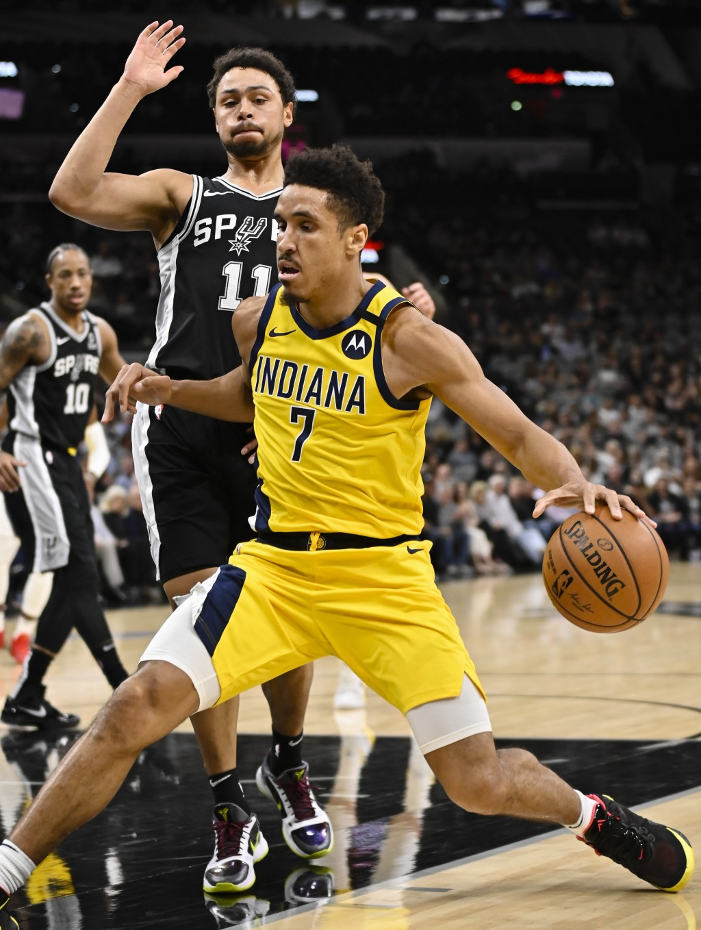 Indiana Pacers' Malcolm Brogdon (7) drives against San Antonio Spurs' Bryn Forbes during the first half of an NBA basketball game, Monday, March 2, 20...