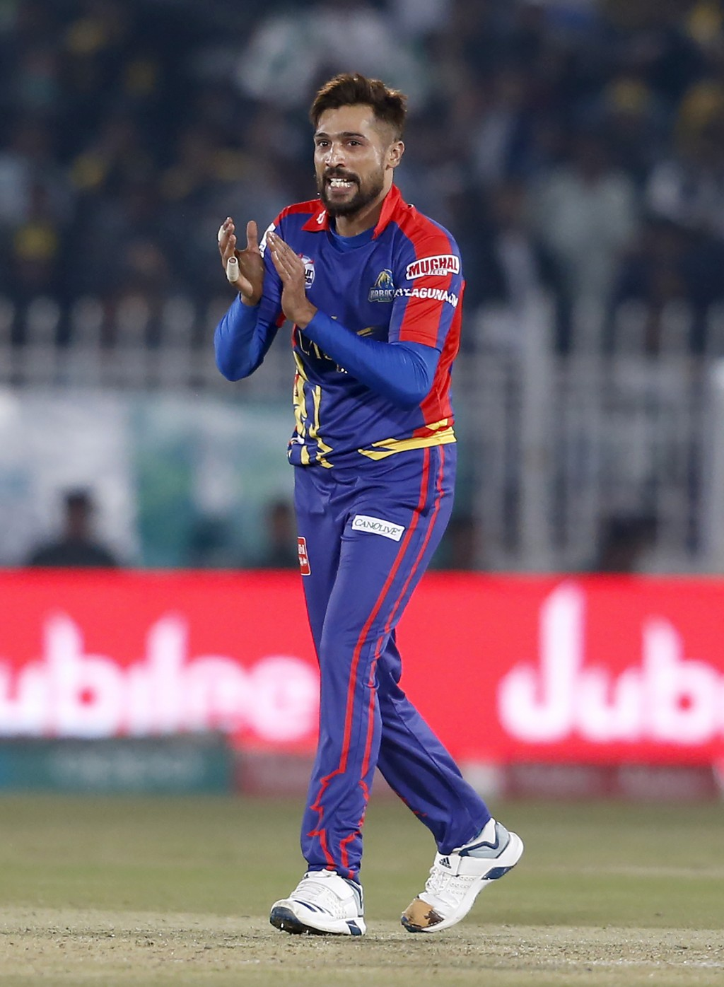 Karachi Kings pacer Mohammad Amir celebrates after taking the wicket of Peshawar Zalmi batsman Lewis Gregory during the Pakistan Super League T20 cric...