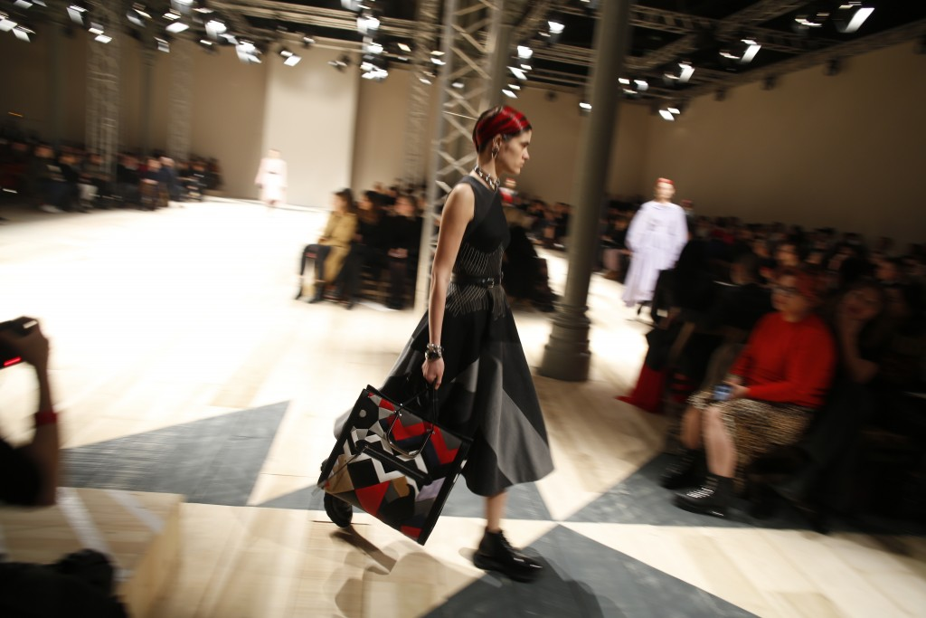 A model wears a creation for the Alexander McQueen fashion collection during Women's fashion week Fall/Winter 2020/21 presented in Paris, Monday, Marc...