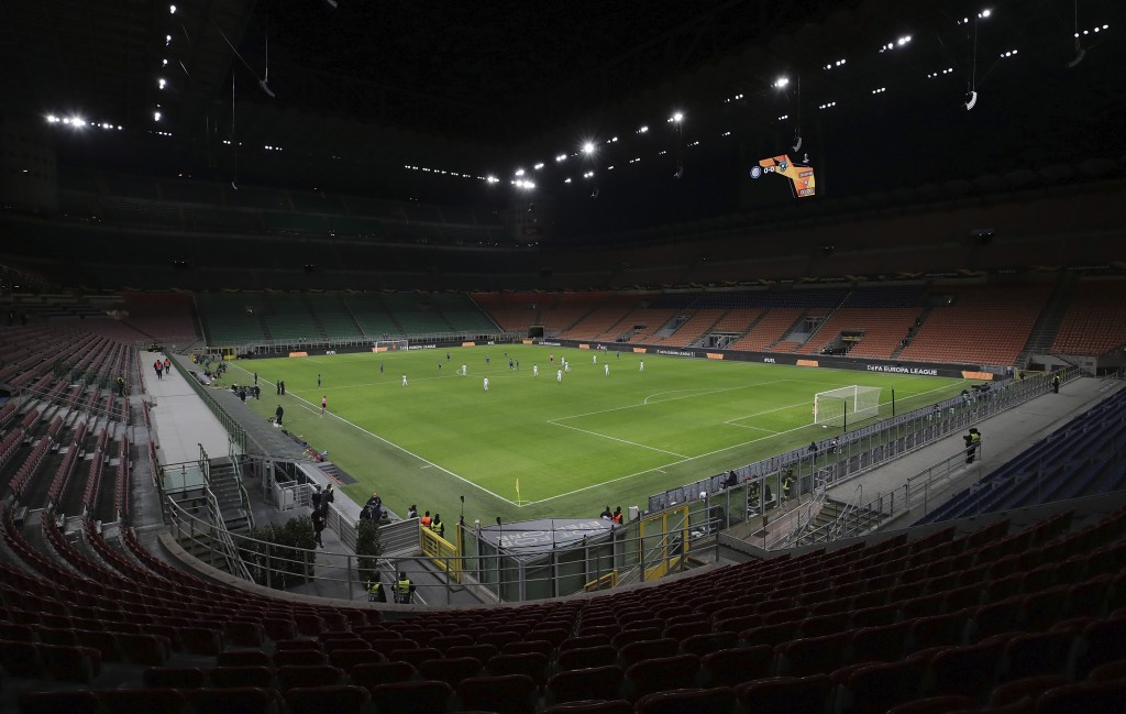 FILE - The seats are empty as a precaution against the coronavirus at the San Siro stadium in Milan, Italy, during the Europa League round of 32 secon...