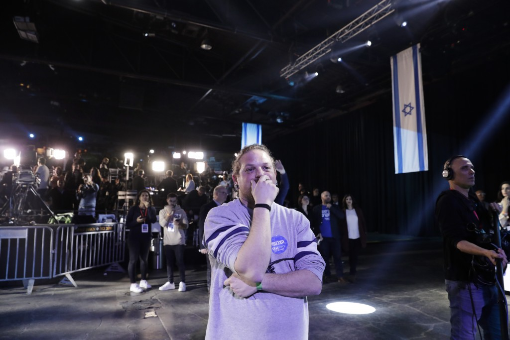 Blue and White party supporter reacts at first exit polls for the Israeli elections at party's headquarters in Tel Aviv, Israel, Monday, March 2, 2020...