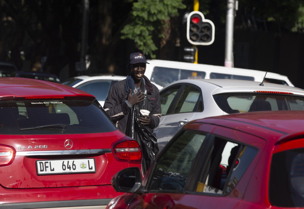 In this photo taken Wednesday, Feb. 26, 2020 a man begs at a busy Johannesburg intersection. Official statistics released Tuesday, March 3, 2020 shows...