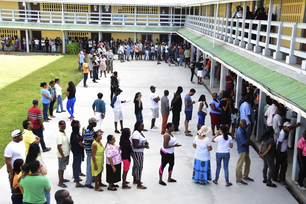 People line up to vote during presidential elections in Georgetown, Guyana, Monday, March. 2, 2020. Guyana get to choose for a new government in a bru...