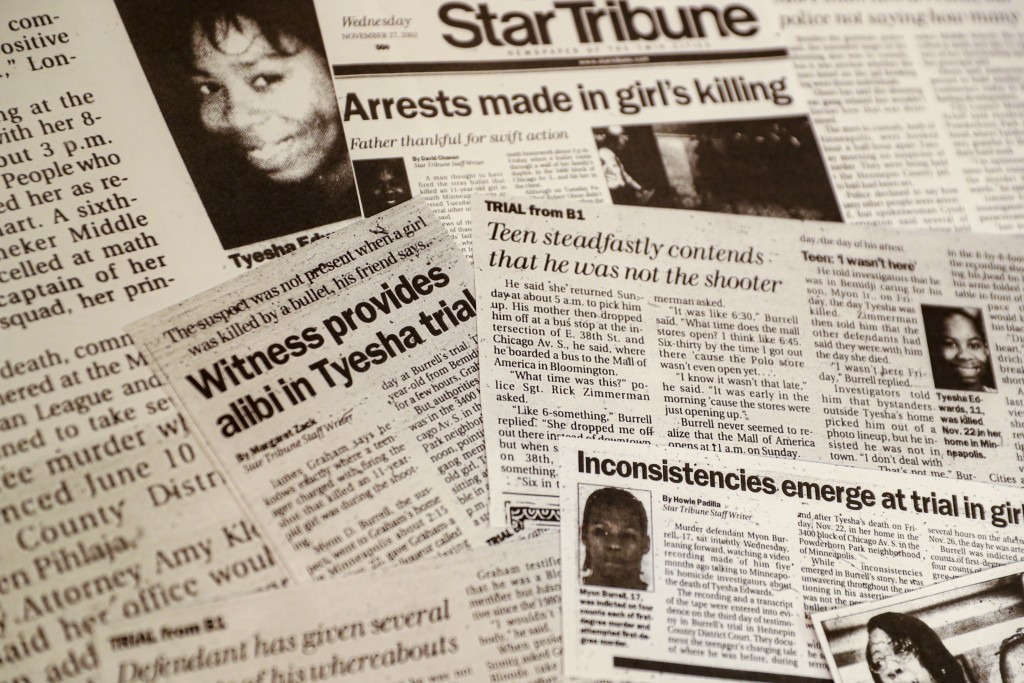 This Oct. 24, 2019, photo shows a collection of newspaper clippings on the progress of the murder trail against Myon Burrell in the stray-bullet killi...