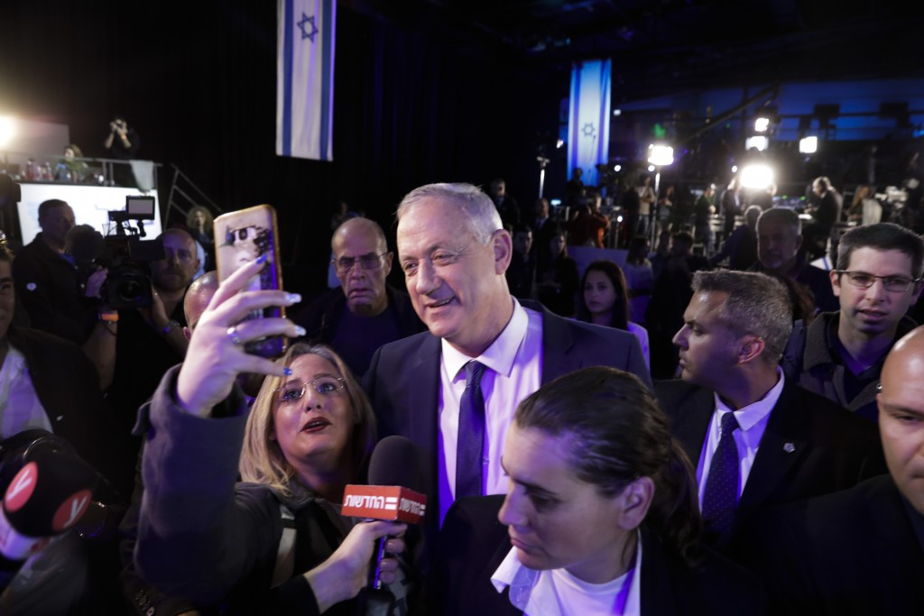 Blue and White party leader Benny Gantz arrives after exit polls for the Israeli elections at party's headquarters in Tel Aviv, Israel, Monday, March ...