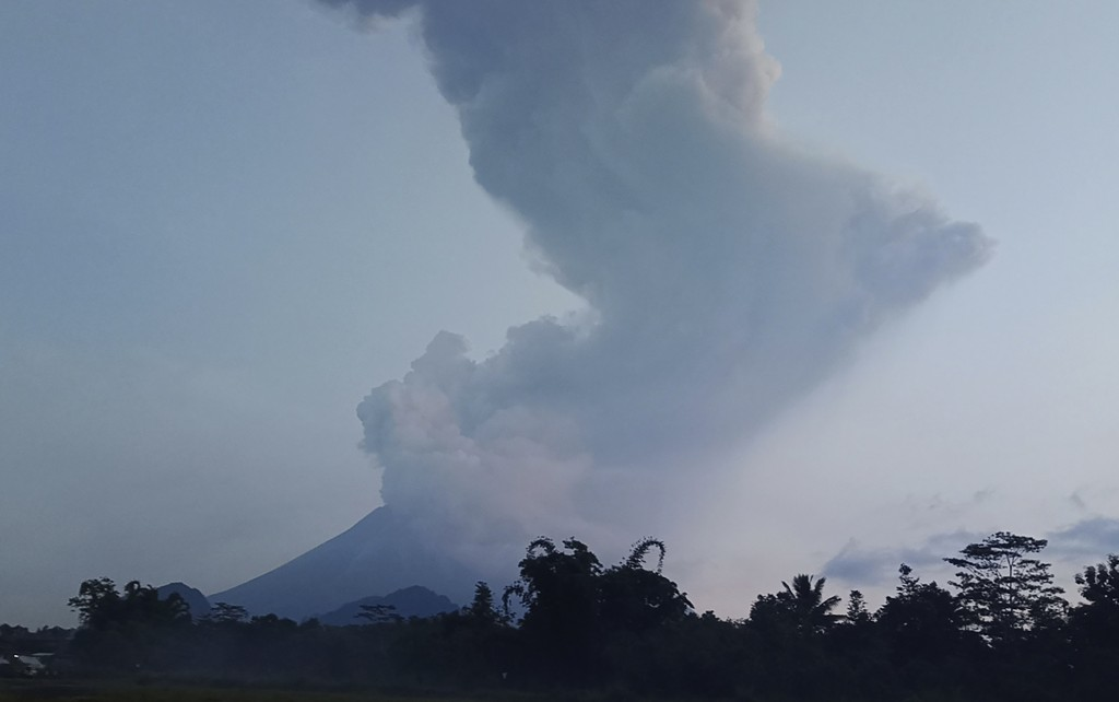 Mount Merapi spews volcanic material into the air in Sleman, Indonesia, Tuesday, March 3, 2020. Indonesia's most active volcano erupted Tuesday, spewi...