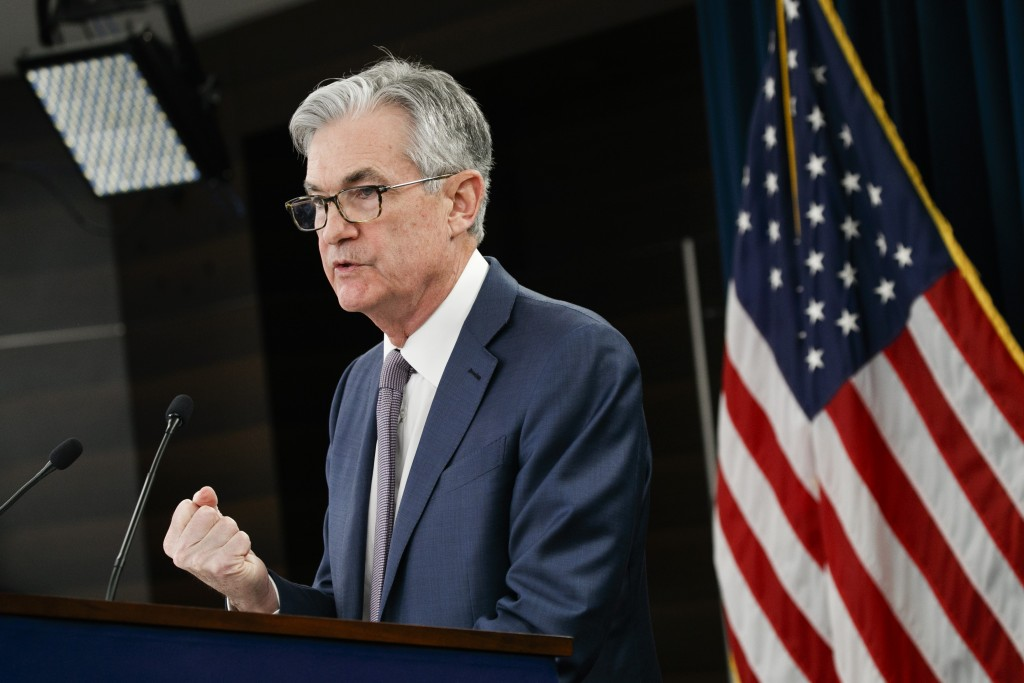 Federal Reserve Chair Jerome Powell speaks during a news conference, Tuesday, March 3, 2020, to discuss an announcement from the Federal Open Market C...
