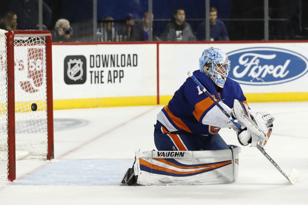 A shot by Montreal Canadiens right wing Brendan Gallagher goes into the net behind New York Islanders goaltender Thomas Greiss (1) during the first pe...