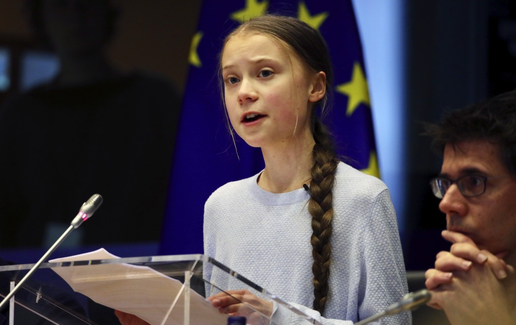 Swedish climate activist Greta Thunberg addresses a meeting of the Environment Council at the European Parliament in Brussels, Wednesday, March 4, 202...