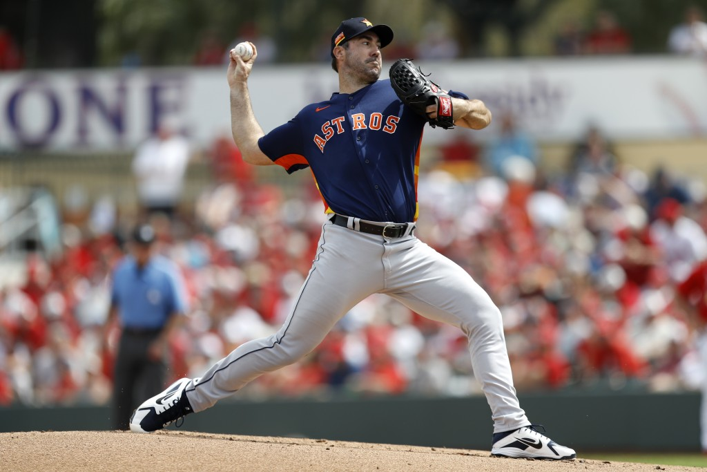 Houston Astros pitcher Justin Verlander throws a pitch during the first inning of a spring training baseball game against the St. Louis Cardinals, Tue...