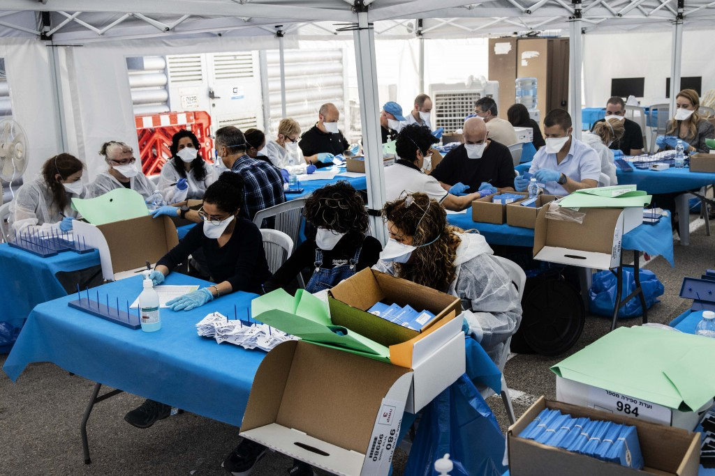 Electoral officials count ballots cast by Israelis under home quarantine after returning from Coronavirus infected zones in the city of Shoham, Israel...