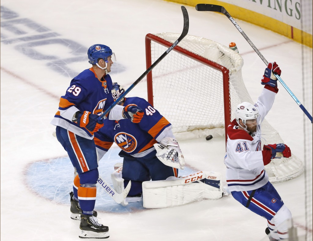 Montreal Canadiens left wing Paul Byron (41) celebrates after scoring a goal against New York Islanders goaltender Semyon Varlamov (40), as Islanders ...