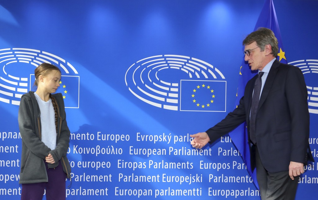 European Parliament President David Sassoli, right, reaches out to shake hands with Swedish climate activist Greta Thunberg during arrival for a meeti...