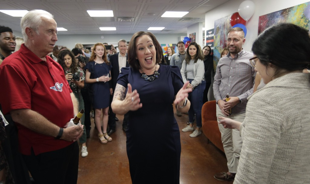 Democratic U.S. Senate candidate MJ Hegar, center, greets supporters during her election night party in Austin, Texas, Tuesday, March 3, 2020. (AP Pho...