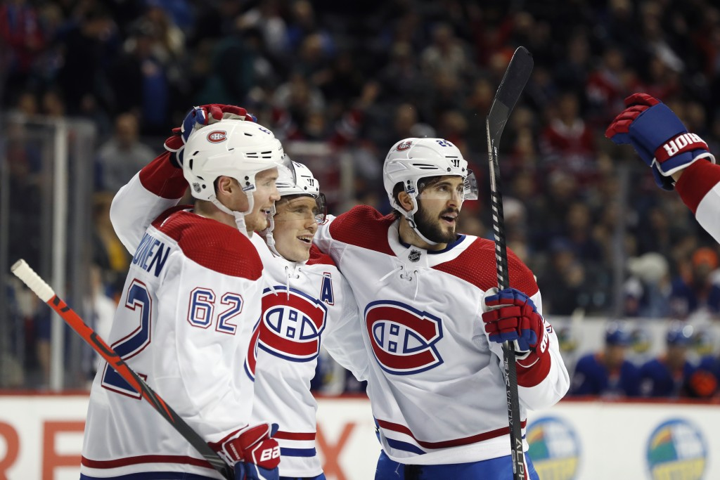 Montreal Canadiens right wing Brendan Gallagher, center, celebrates with left wing Artturi Lehkonen (62) and center Phillip Danault after scoring agai...