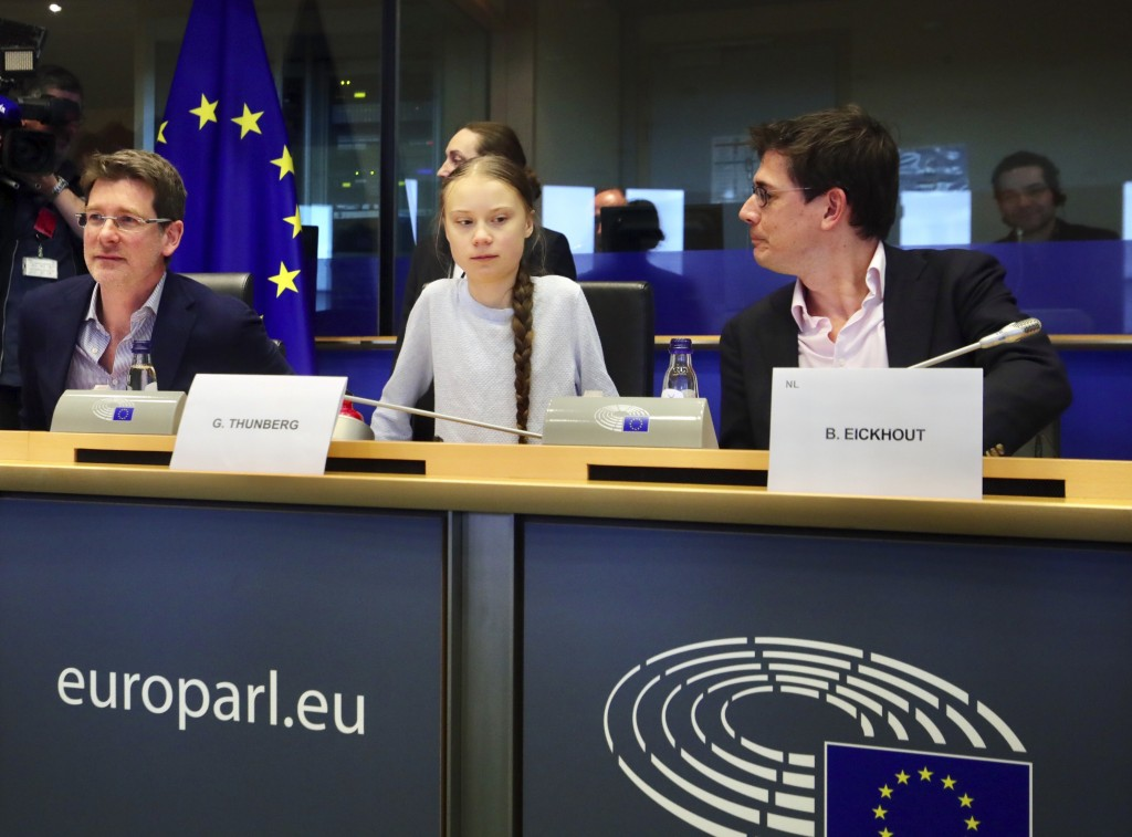 Swedish climate activist Greta Thunberg, center, addresses a meeting of the Environment Council at the European Parliament in Brussels, Wednesday, Mar...