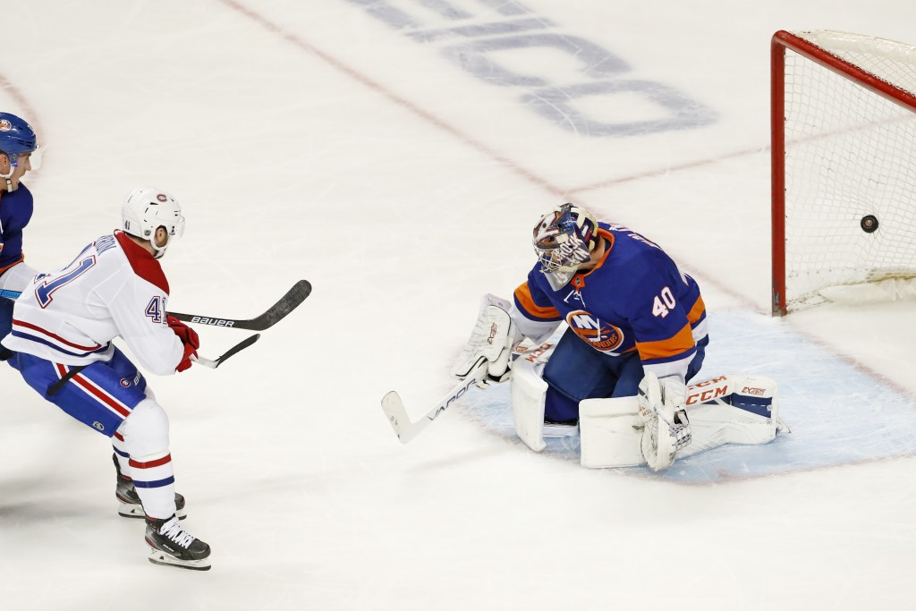 Montreal Canadiens left wing Paul Byron (41) watches his power-play goal go into the net behind New York Islanders goaltender Semyon Varlamov (40) dur...