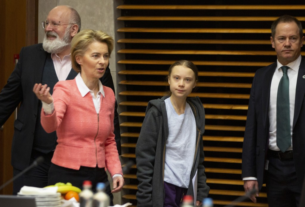 Swedish climate activist Greta Thunberg, center, and European Commission President Ursula von der Leyen, second left, arrive for the weekly College of...