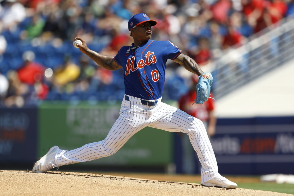 New York Mets pitcher Marcus Stroman throws a pitch to the St. Louis Cardinals during the first inning of a spring training baseball game, Wednesday, ...